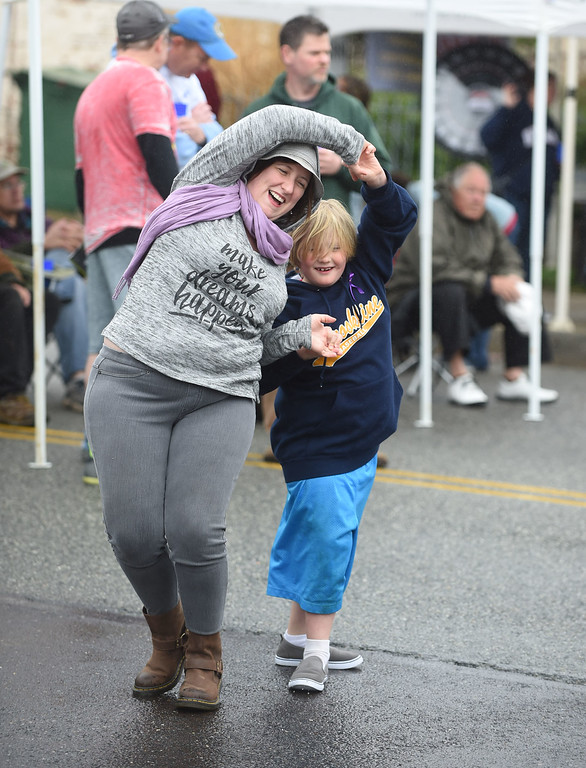 . PETE BANNAN-DIGITAL FIRST MEDIA  Cia Canaglia dances with her son, Ian at the Haverford Spring Music Festival on Sunday May 1 on Brookline Blvd. in Havertown. The rain or shine event  featured six bands including The Verve Pipe and Chico\'s Vibe.