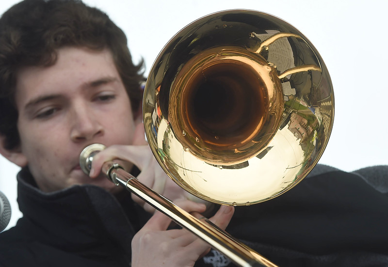PETE BANNAN-DIGITAL FIRST MEDIA  Trumpeter Mike Kaplan of the Haverford Jazz ensemble performs a solo at the Haverford Spring Music Festival on Sunday May 1 on Brookline Blvd. in Havertown. The rain or shine event  featured six bands including The Verve Pipe and Chico's Vibe.