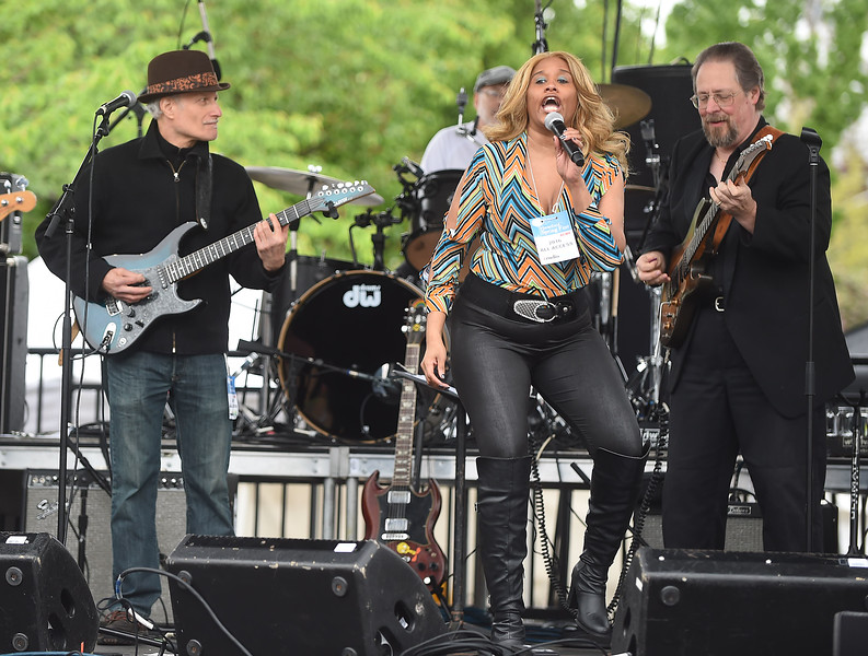 PETE BANNAN-DIGITAL FIRST MEDIA  Lisa Chavous and the Philadelphia Bluse Messengers perform at the Haverford Spring Music Festival on Sunday May 1 on Brookline Blvd. in Havertown.