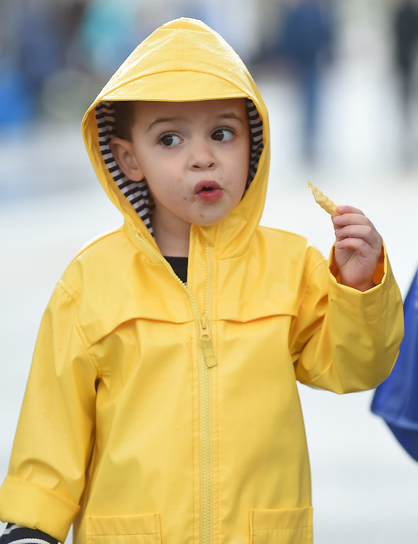 . PETE BANNAN-DIGITAL FIRST MEDIA  Max Perry, 3,of Havertown enjoys a french fry andsome music at the Haverford Spring Music Festival on Sunday May 1 on Brookline Blvd. in Havertown. The rain or shine event  featured six bands including The Verve Pipe and Chico\'s Vibe.