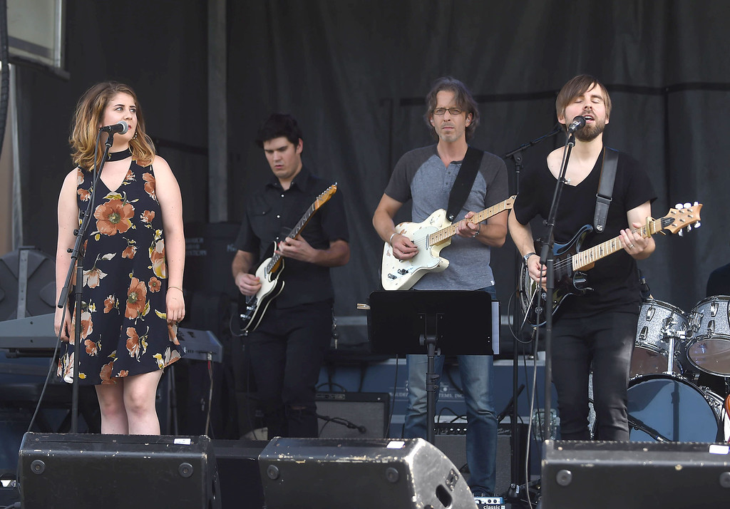. PETE BANNAN-DIGITAL FIRST MEDIA    TBen O\'Neill and his band  perform on the Oakmont field at the Haverford Music Festival  Saturday Sept. 10, 2016.