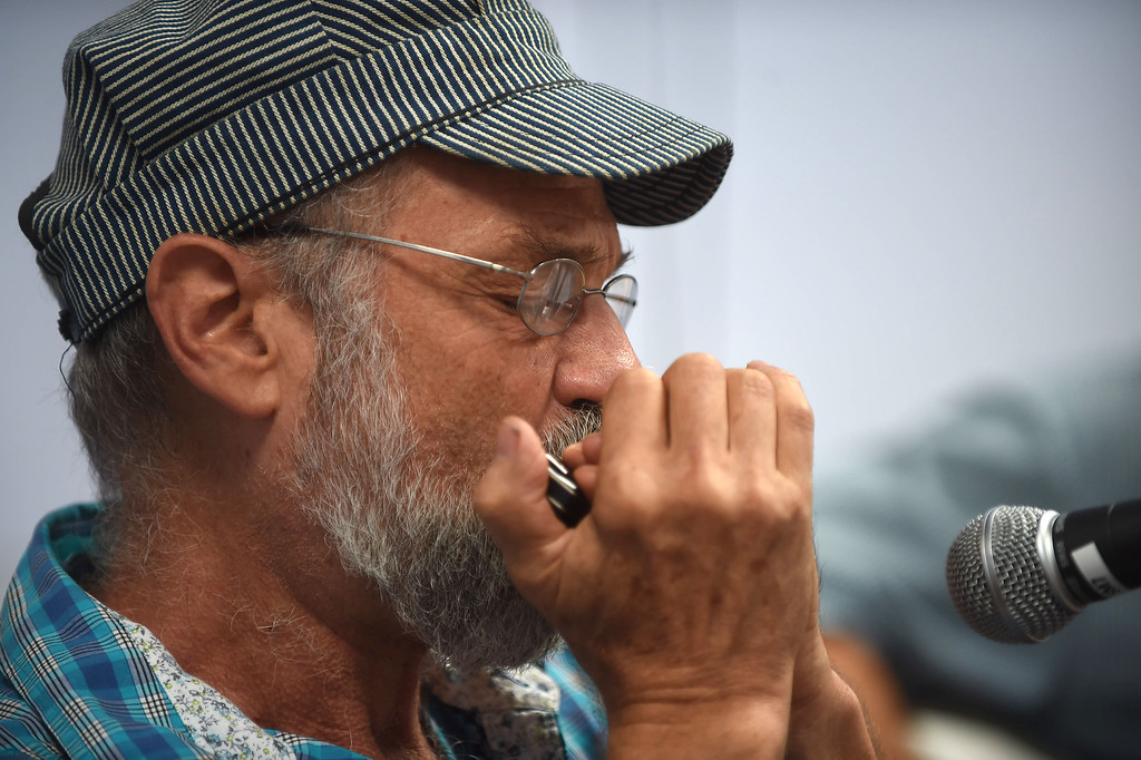 . PETE BANNAN-DIGITAL FIRST MEDIA    Mike Tratner, of Wynnewood plays the harmonica as part of  \'Blind Sample &The Untrue Blues Band\'  at the Haverford Music Festival Saturday.
