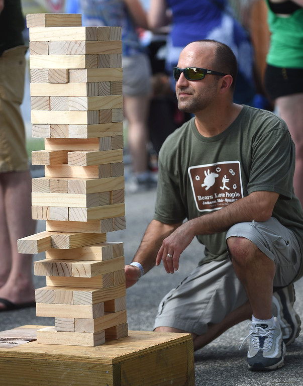 . PETE BANNAN-DIGITAL FIRST MEDIA   David Lemisch of Havertown takes a break from the music to play \'Jenga\'  at the Haverford Music Festival Saturday.