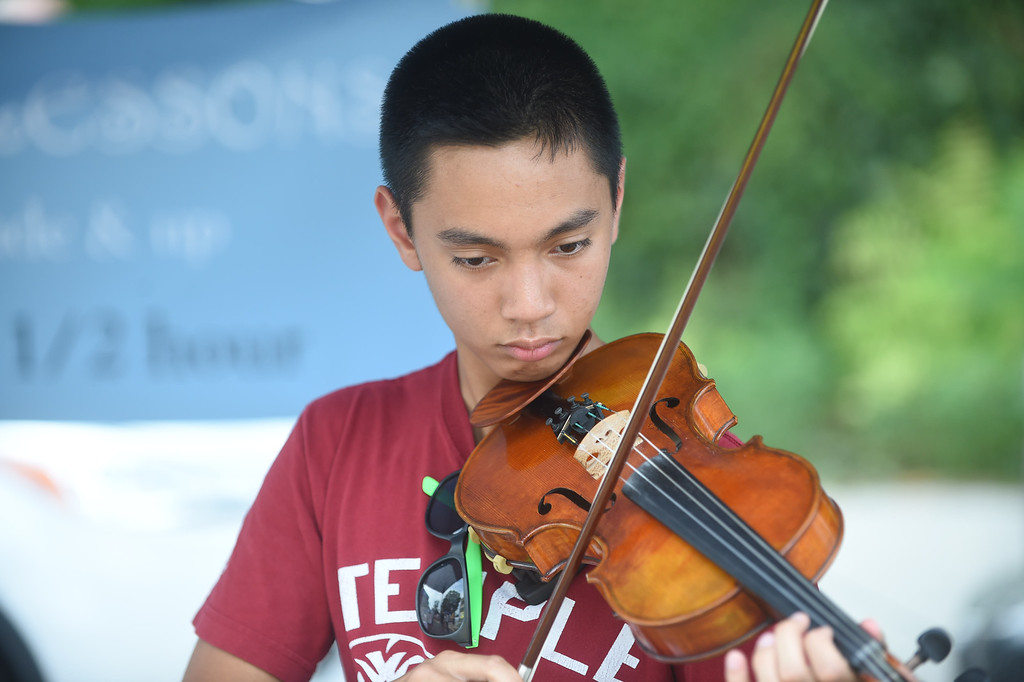 . PETE BANNAN-DIGITAL FIRST MEDIA    Haverford High School student Ralph Lopez displays his violin skills at the Haverford Music Festival .An aspiring businessman, Lopez had a booth offering to each students. He is also a member of the Philadelphia Youth Orchestra.