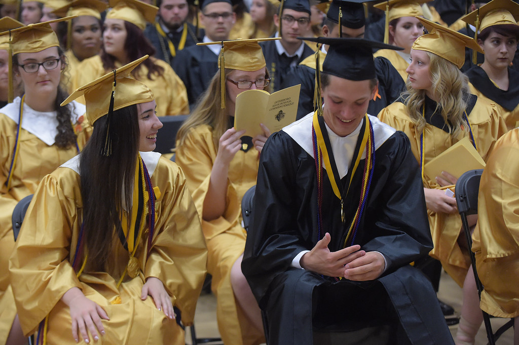 . PETE BANNAN - DIGITAL FIRST MEDIA       Interborohigh school Valedictorian  Kaitlyn  Klotz and Salutatorian Joseph Pitt enjoy a laugh following their speeches at graduation  at Neumann University Tuesday evening.