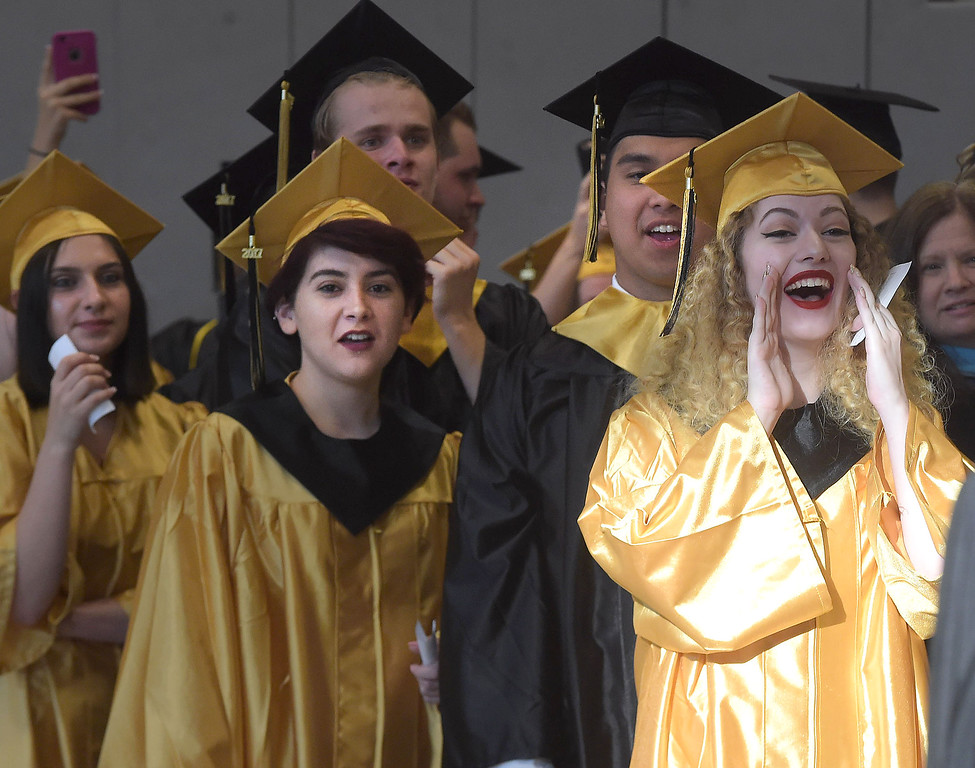 . PETE BANNAN - DIGITAL FIRST MEDIA       Interboro graduates give a final cheer while waiting for commencemt exercises at Neumann University Tuesday evening.