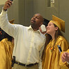 PETE BANNAN - DIGITAL FIRST MEDIA       Interboro counselor Brian Hines takes a photo with senior Erica DiEmedio prior to commencemt exercises at Neumann University Tuesday evening.
