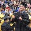 PETE BANNAN - DIGITAL FIRST MEDIA       Interboro graduate Christopher J. Thomas holds up his newly minted diploma during commencemt exercises at Neumann University Tuesday evening.