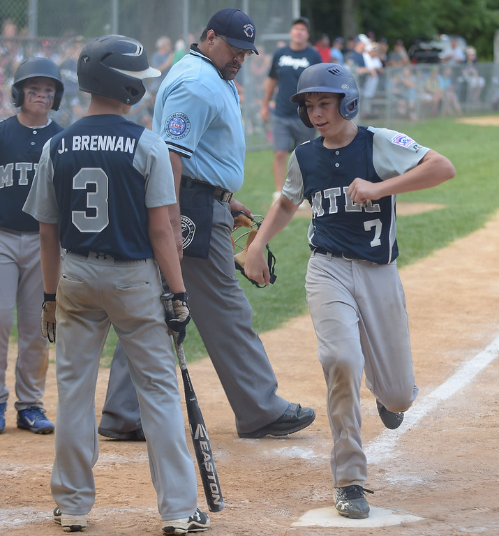 . PETE BANNAN  DIGITAL FIRST MEDIA   Owen Mathes crosses homeplate after hitting his second home run in the District 19 Little League finals match-up between Drexel Hill and Marple.  Marple won 10-1, Mathes also pitched in the victory.