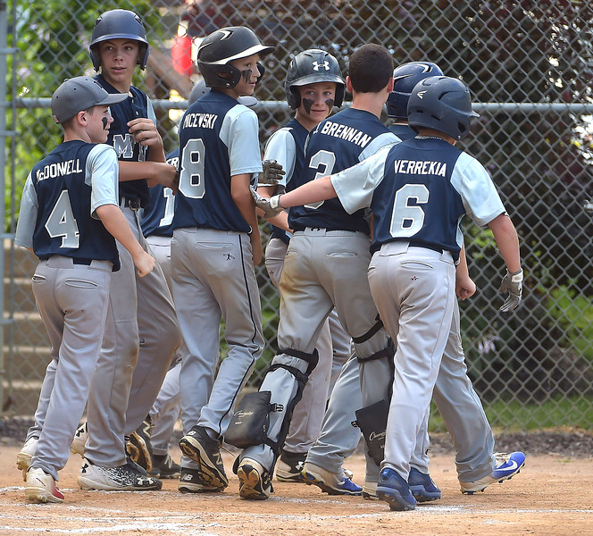 PETE BANNAN  DIGITAL FIRST MEDIA  Marple Little League players surround teammate (8) Jake Micewski  after he hit his second home run in the District 19 Little League finals match-up between Drexel Hill and Marple.  Marple won 10-1, the two teams will play again Tuesday evening for the title.