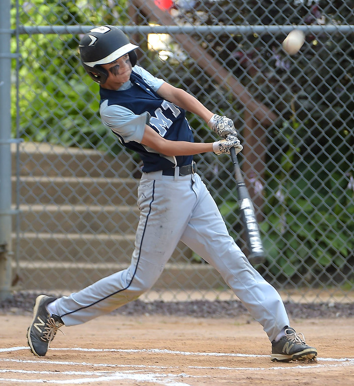 . PETE BANNAN  DIGITAL FIRST MEDIA  Marple Little League (8) Jake Micewski hits a three-run homerun in the  first inning of theDistrict 19 Little League finals match-up Drexel Hill Monday evening at Aston-Middletown Little League complex.  Marple won 10-1 Miceeski also had a two-run homerun in the victory.