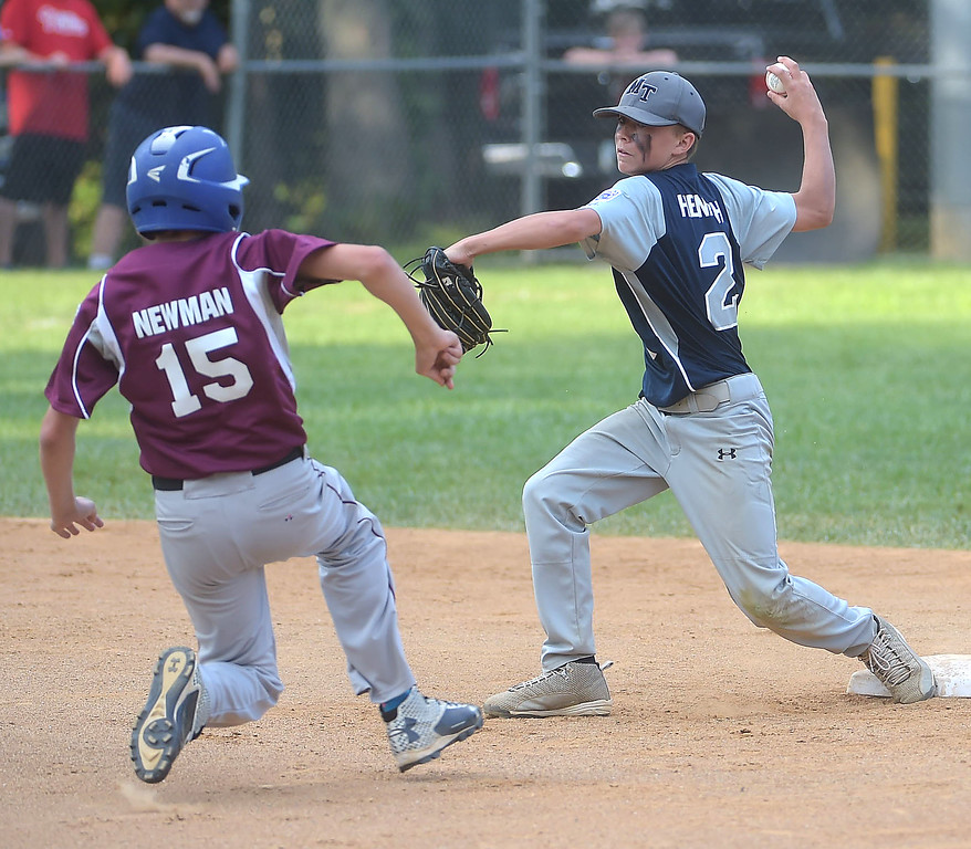 . PETE BANNAN  DIGITAL FIRST MEDIA  Marple shortstop Kevin Henrich forces out Drexel Hill (1) CC Newman and throws to first trying for a doubleplay in the District 19 Little League finals match-up between Drexel Hill and Marple. THe runner at first was save as Marple won 10-1 to extend the series to Tuesday evening.