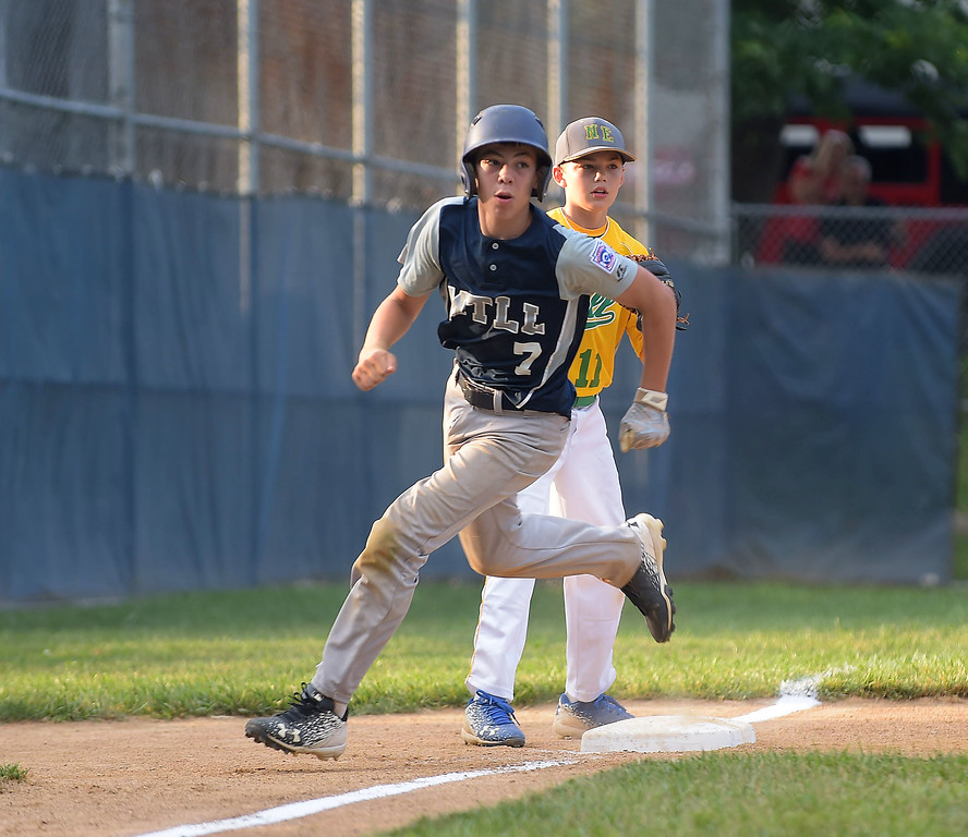 . PETE BANNAN  DIGITAL FIRST MEDIA   Marple\'s Owen Mathes circles third in District 19 Little League tournament action against Newtown-Edgmont Wednesday evening at Marple Little League field. Marple won 16-2 in 4 innings of play. Mathes had a homerun in the victory.