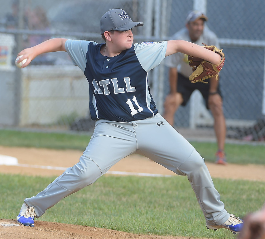 . PETE BANNAN  DIGITAL FIRST MEDIA   Marple pitcher ALex Bruno throws in District 19 Little League tournament action against Newtown-Edgmont Wednesday evening at Marple Little League field. Marple won 16-2 in 4 innings of play.