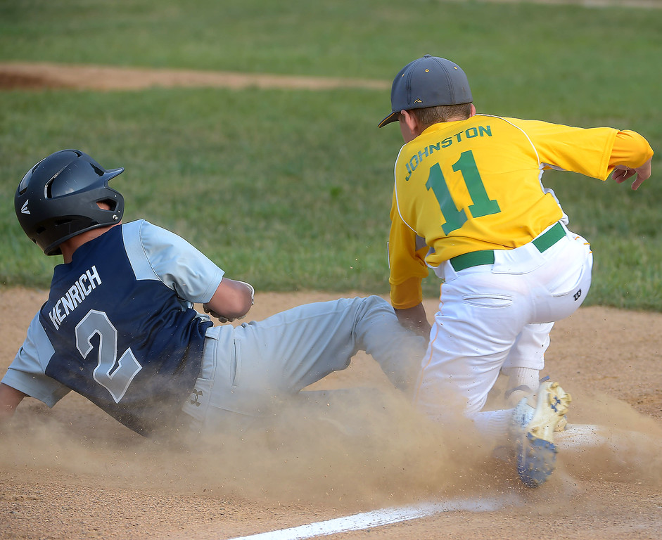 . PETE BANNAN  DIGITAL FIRST MEDIA   Marple\'s Kevin Henrich is safe at third base in District 19 Little League tournament action as Newtown-Edgmont \'s Brad Johnston covers Wednesday evening at Marple Little League field. Marple won 16-2 in 4 innings of play.