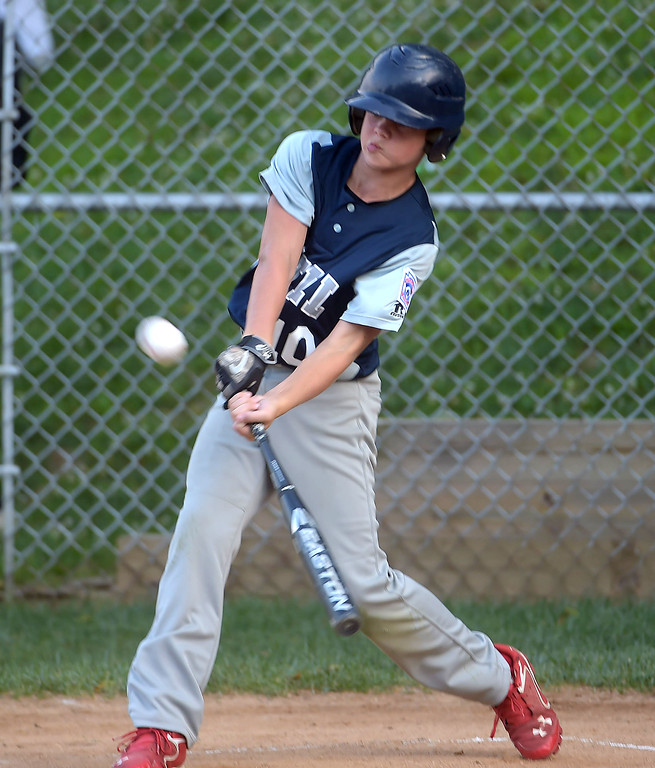 . PETE BANNAN  DIGITAL FIRST MEDIA   Marple\'s Jonny Small tees off on a pitch for a home run in District 19 Little League tournament action against Newtown-Edgmont Wednesday evening at Marple Little League field. Marple won 16-2 in 4 innings of play.