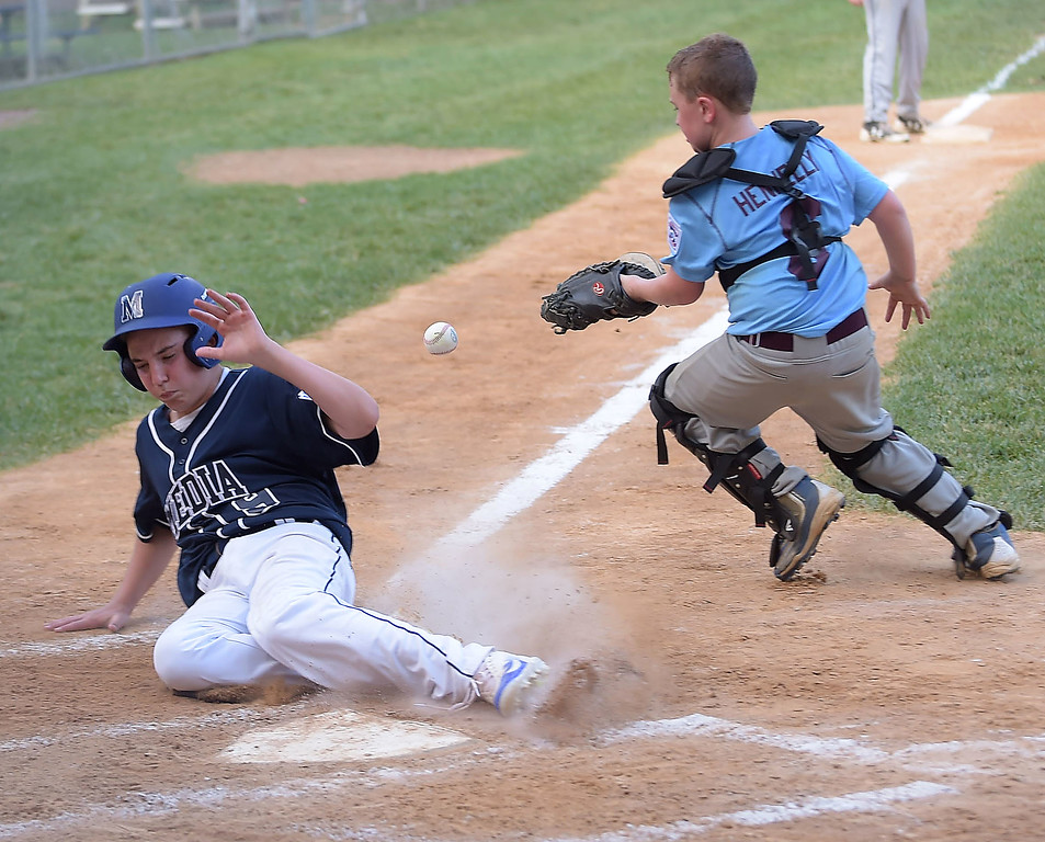 . PETE BANNAN  DIGITAL FIRST MEDIA  Media runner Jack Edwards beats the throw home as South Marple catcher Aiden Hennelly  covers in Media\'s 14-1 victory in District 19 Little League playoffs at Aston-Middletown  Monday evening.