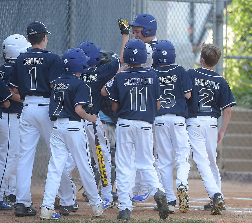 . PETE BANNAN  DIGITAL FIRST MEDIA  Media teammates surround Jack Edwards after he hit a grand slam homerun agaisnt South Marple that was all Media needed in their 14-1 victory in District 19 Little League playoffs at Aston-Middletown  Monday evening.