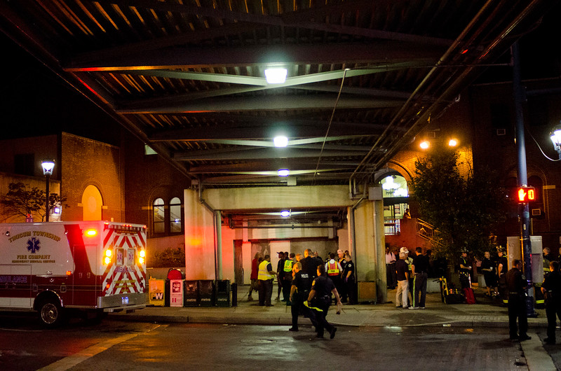 RICK KAUFFMAN - DIGITAL FIRST MEDIA <br /> First reponders worked dilligently to extract the injured from a train collision at 69th Street Terminal Tuesday morning, seen here filing people to awaiting shuttle busses from under the pedestrian bridge.