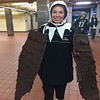 Sabrina Tusavitz of Limerick shows how she's transformed into an Eagle at 30th St station. Photo by Kathleen E. Carey