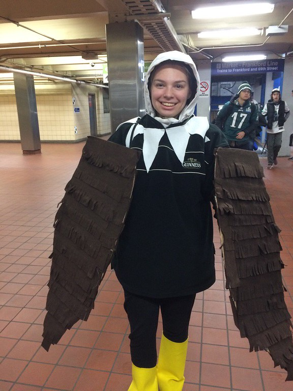 . Sabrina Tusavitz of Limerick shows how she\'s transformed into an Eagle at 30th St station. Photo by Kathleen E. Carey