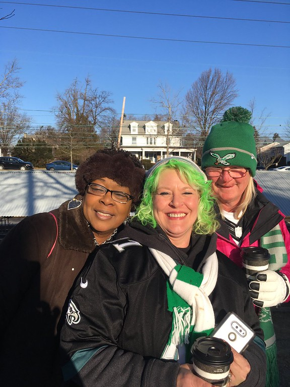 ". Carol Ferkler of Ridley Park is a ""dye-hard\"" Eagles fan and on her way to Philly to celebrate her team with friend Michele Cordove of Prospect Park. Also in photo is SEPTA ticket-taker Teresa Christy-Hayes, left. Photo by Rose Quinn"