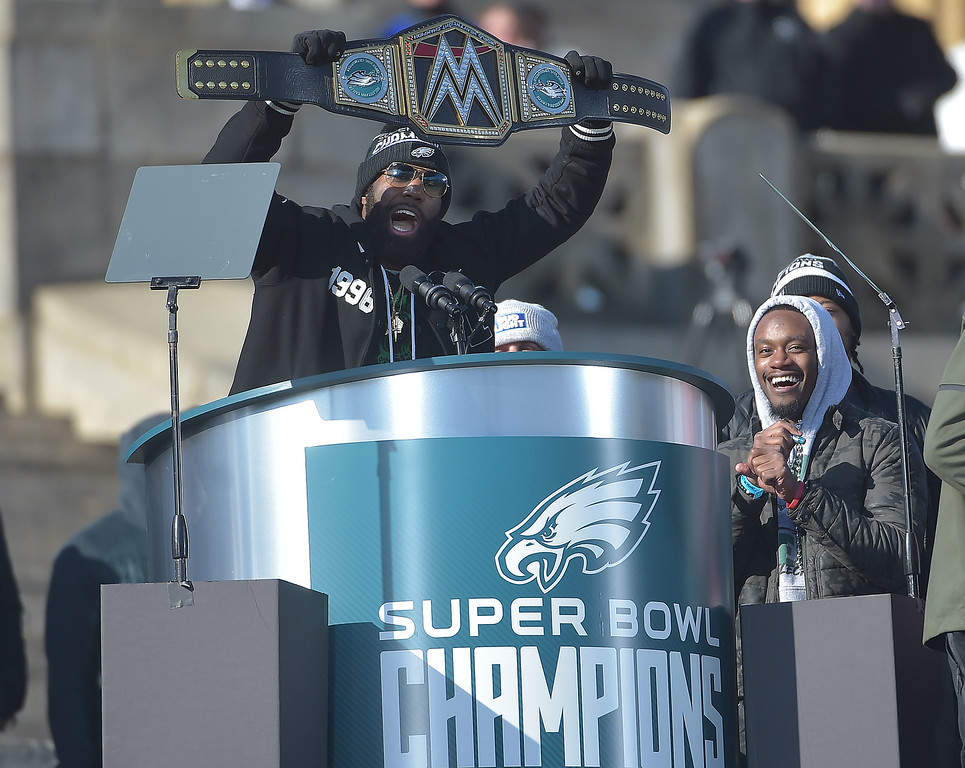 . PETE BANNAN-DIGITAL FIRST MEDIA        Malcolm Jenkins holds a champion belt during the Eagles Championship Celebration.