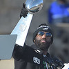 PETE BANNAN-DIGITAL FIRST MEDIA        Malcom Jenkins holds up the Vince Lombardi trophy during the Eagles Championship Celebration.