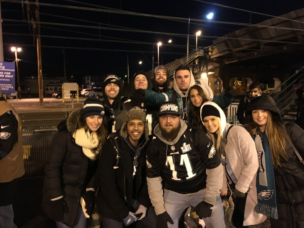 . Friends from high school and college gathered in Marcus Hook to get to the Eagles parade.Photo by Rose Quinn.