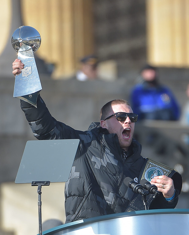 . PETE BANNAN-DIGITAL FIRST MEDIA     Zach Ertz holds up the Vince Lombardi trophy during the Eagles Championship Celebration.