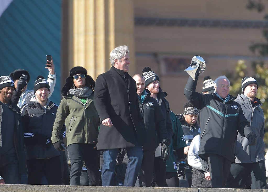 . PETE BANNAN-DIGITAL FIRST MEDIA       Eagles coach Doug Pederson and  owner, Jeff Laurie withthe Vince Lombardi Trophy lead the team down the steps at the Philadelphia Art Museum for the Eagles Championship Celebration.