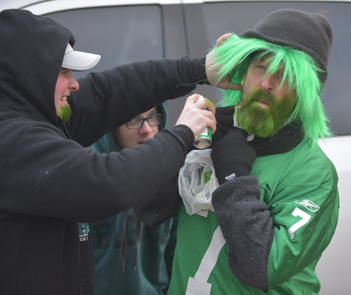 PETE BANNAN-DIGITAL FIRST MEDIA    Eddie Lee Johnson gets his beard spreayed green before the Eagle parade. He came down from thePoconos for the parade.