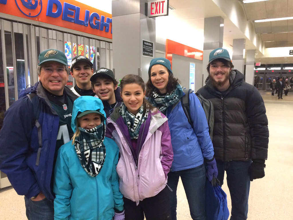 . The Miller family of Yardley, PA., and friend Ryan (right) expected fun as they boarded a SEPTA 5:25 a.m. train to the Eagles championship parade.