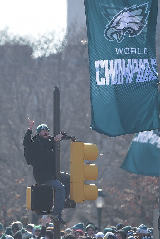 . PETE BANNAN-DIGITAL FIRST MEDIA       This fan had a birdseye during the Eagles Championship Celebration. The police eventually told him to get down.