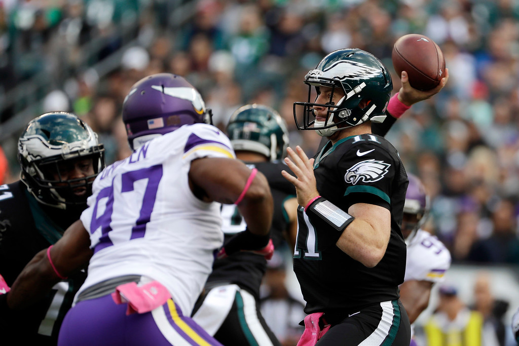 . Philadelphia Eagles\' Carson Wentz passes during the first half of an NFL football game against the Minnesota Vikings, Sunday, Oct. 23, 2016, in Philadelphia. (AP Photo/Michael Perez)