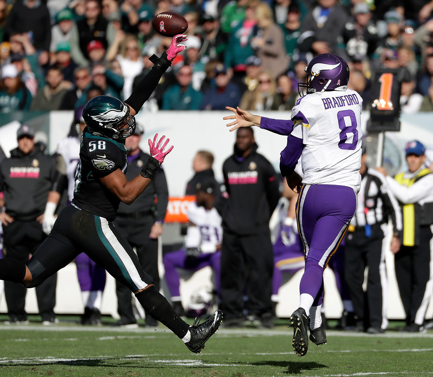 . Minnesota Vikings\' Sam Bradford, right, tries to pass against Philadelphia Eagles\' Jordan Hicks during the second half of an NFL football game, Sunday, Oct. 23, 2016, in Philadelphia. (AP Photo/Michael Perez)