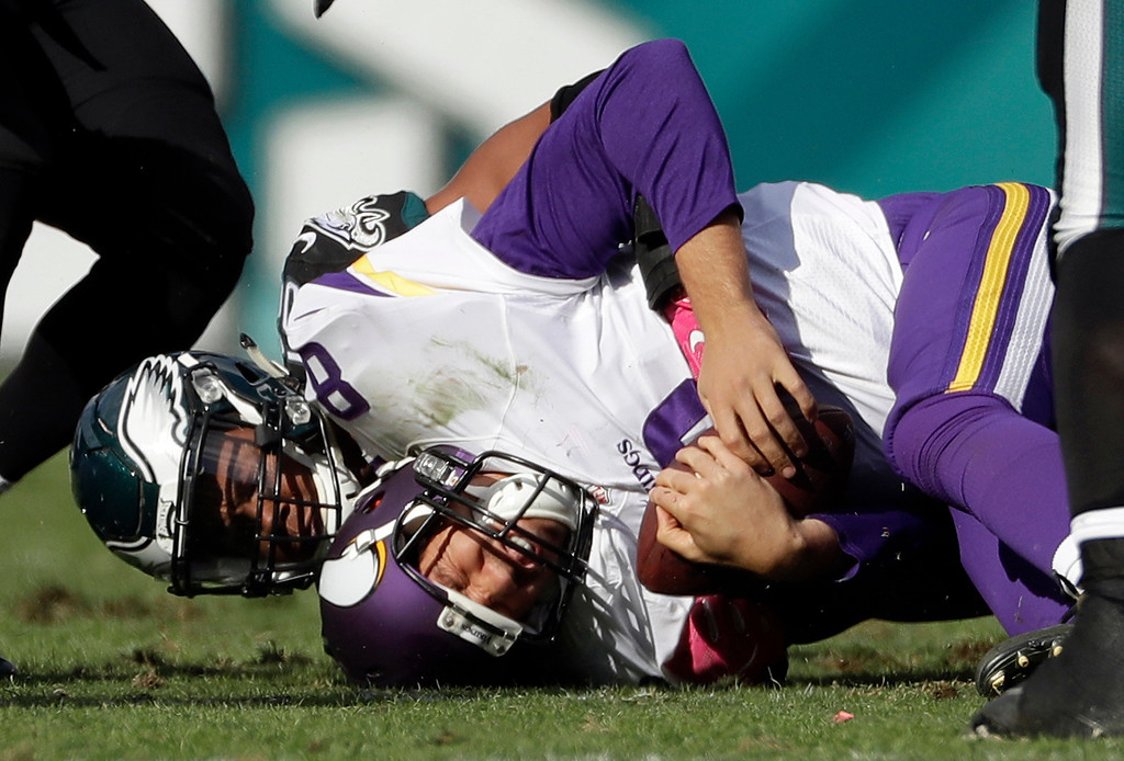 . Minnesota Vikings\' Sam Bradford (8) is tackled by Philadelphia Eagles\' Jordan Hicks during the second half of an NFL football game, Sunday, Oct. 23, 2016, in Philadelphia. (AP Photo/Michael Perez)