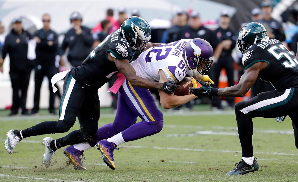 . Minnesota Vikings\' Kyle Rudolph (82) is tackled by Philadelphia Eagles\' Nolan Carroll (22) and Nigel Bradham (53) during the second half of an NFL football game Sunday, Oct. 23, 2016, in Philadelphia. (AP Photo/Chris Szagola)