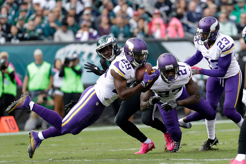 . Minnesota Vikings\' Xavier Rhodes (29) intercepts a pass during the first half of an NFL football game against the Philadelphia Eagles, Sunday, Oct. 23, 2016, in Philadelphia. (AP Photo/Chris Szagola)