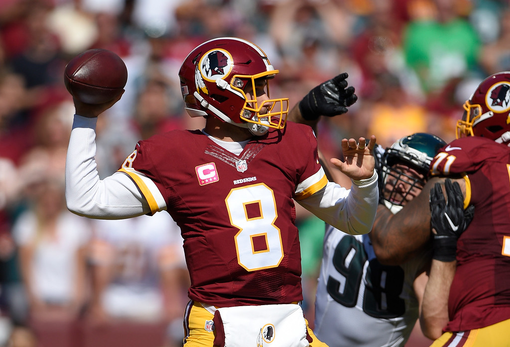 . Washington Redskins quarterback Kirk Cousins (8) throws to a receiver in the first half of an NFL football game against the Philadelphia Eagles, Sunday, Oct. 16, 2016, in Landover, Md. (AP Photo/Nick Wass)