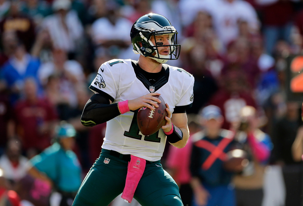 . Philadelphia Eagles quarterback Carson Wentz looks for a receiver in the second half of an NFL football game against the Washington Redskins, Sunday, Oct. 16, 2016, in Landover, Md. (AP Photo/Mark Tenally)