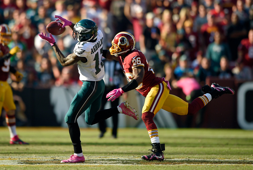. Philadelphia Eagles wide receiver Nelson Agholor, left, makes a catch in front of Washington Redskins cornerback Bashaud Breeland in the second half of an NFL football game, Sunday, Oct. 16, 2016, in Landover, Md. (AP Photo/Nick Wass)