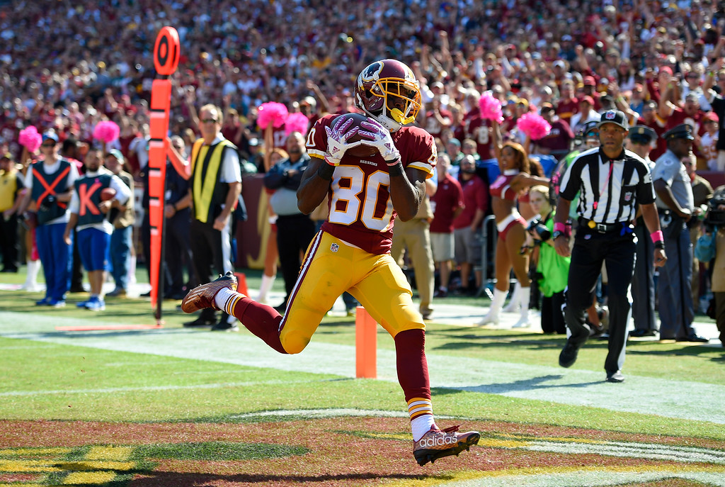 . Washington Redskins wide receiver Jamison Crowder scores a touchdown in the first half of an NFL football game against the Philadelphia Eagles, Sunday, Oct. 16, 2016, in Landover, Md. (AP Photo/Nick Wass)