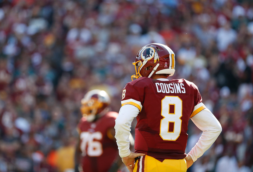. Washington Redskins quarterback Kirk Cousins (8) stands on the field in the second half of an NFL football game against the Philadelphia Eagles, Sunday, Oct. 16, 2016, in Landover, Md. (AP Photo/Alex Brandon)
