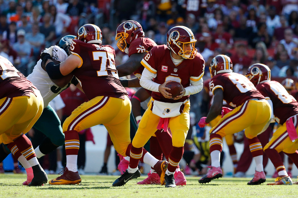 . Washington Redskins quarterback Kirk Cousins (8) drops back in the second half of an NFL football game against the Philadelphia Eagles, Sunday, Oct. 16, 2016, in Landover, Md. (AP Photo/Alex Brandon)