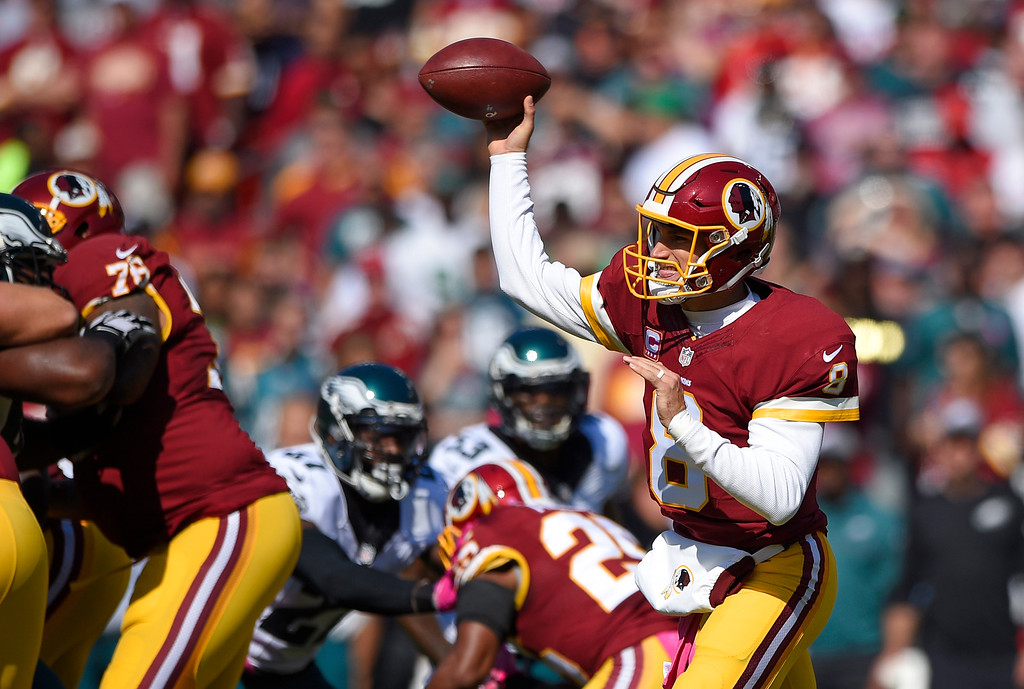 . Washington Redskins quarterback Kirk Cousins throws to a receiver in the first half of an NFL football game against the Philadelphia Eagles, Sunday, Oct. 16, 2016, in Landover, Md. (AP Photo/Nick Wass)