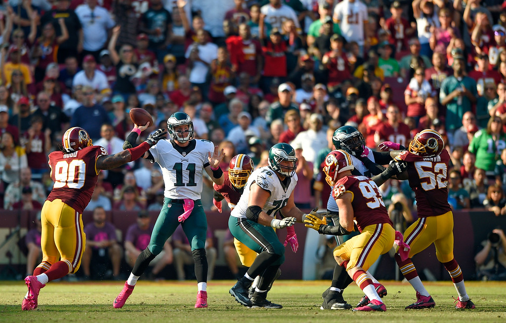 . Philadelphia Eagles quarterback Carson Wentz (11) throws to a receiver in the second half of an NFL football game against the Washington Redskins, Sunday, Oct. 16, 2016, in Landover, Md. (AP Photo/Nick Wass)