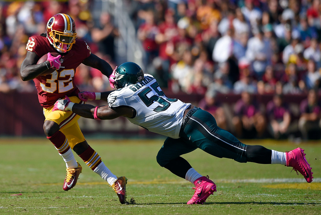 . Washington Redskins running back Rob Kelley, left, pushes away Philadelphia Eagles defensive end Brandon Graham as he rushes the ball in the first half of an NFL football game, Sunday, Oct. 16, 2016, in Landover, Md. (AP Photo/Nick Wass)