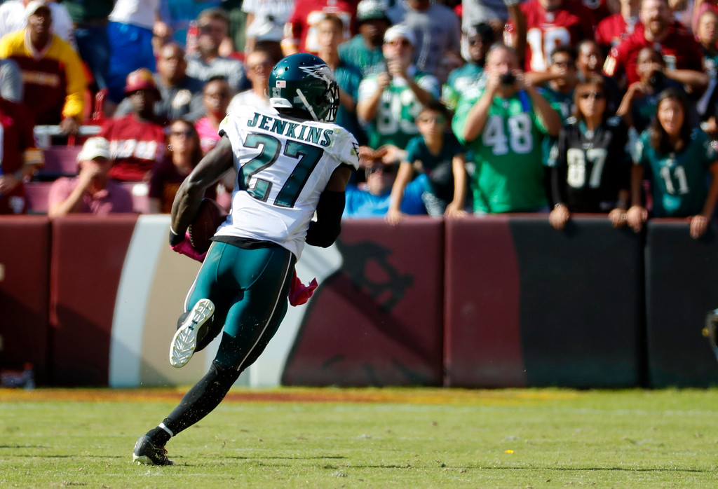 . Philadelphia Eagles strong safety Malcolm Jenkins scores a touchdown on an interception in the first half of an NFL football game against the Washington Redskins, Sunday, Oct. 16, 2016, in Landover, Md. (AP Photo/Alex Brandon)