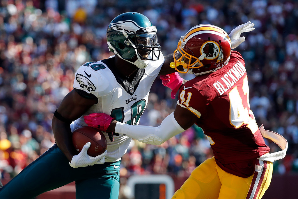 . Philadelphia Eagles wide receiver Dorial Green-Beckham, left, tries to avoid Washington Redskins free safety Will Blackmon as he rushes the ball in the second half of an NFL football game, Sunday, Oct. 16, 2016, in Landover, Md. (AP Photo/Alex Brandon)